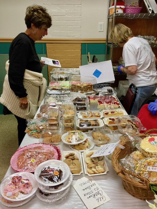 table covered with homemade desserts for sale at church fish fry dinner