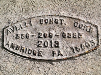 Avelli Construction Corporation sidewalk concrete mason stamp, Pittsburgh, PA