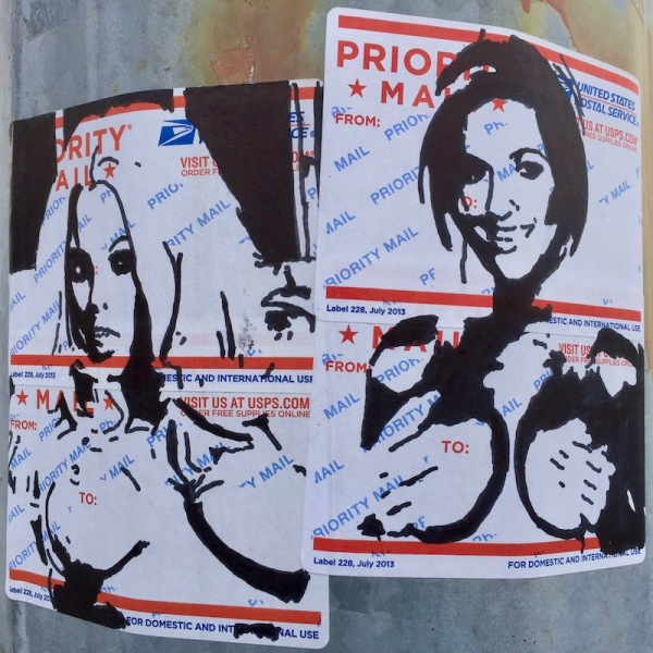 portraits of naked women holding their breasts drawn on US postal service mail labels and stuck to steel light pole, Pittsburgh, PA