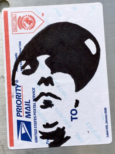 US postal service priority mail sticker with black ink portrait of man with baseball cap, Pittsburgh, PA