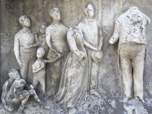 sculptural detail of family with features worn away on marble grave monument, Allegheny Cemetery, Pittsburgh, PA