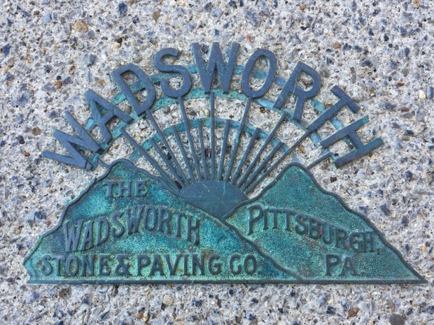 brass plate embedded in sidewalk concrete advertising Wadsworth Stone & Paving company, Pittsburgh, PA