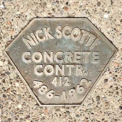 brass sidewalk plaque for Nick Scotti, Concrete Contr., Pittsburgh, PA