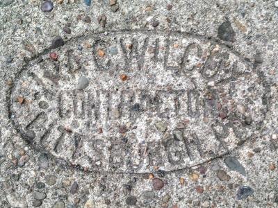 Ira G. Wilcox sidewalk concrete mason stamp, Pittsburgh, PA