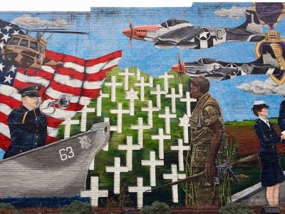 patriotic mural including soldiers, military cemetery, and American flag, Leechburg, PA
