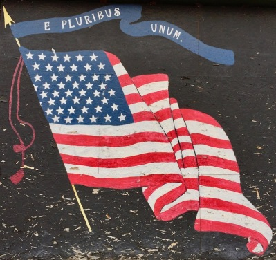 plywood storefront painted like 48-star American flag, West Newton, PA