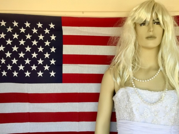 male mannequin dressed as a woman standing in front of American flag, Hawley, PA