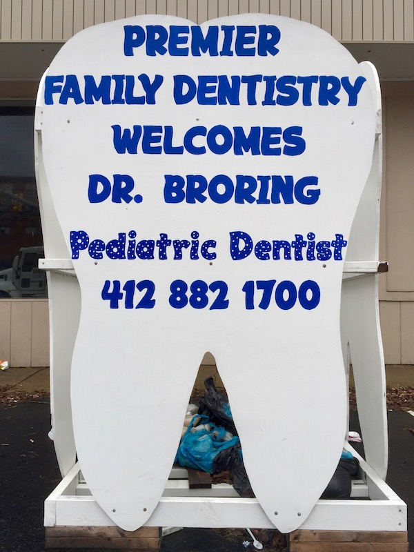 """large tooth-shaped sign reading """"Premier Family Dentistry welcomes Dr. Broring"""", Baldwin Borough, PA"""