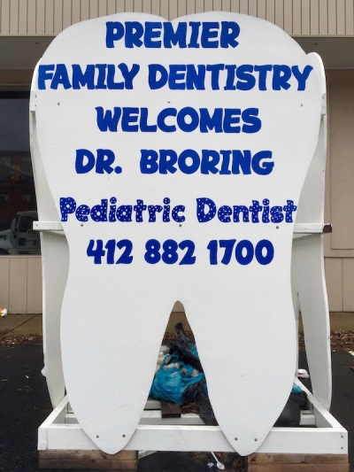 "large tooth-shaped sign reading ""Premier Family Dentistry welcomes Dr. Broring"", Baldwin Borough, PA"
