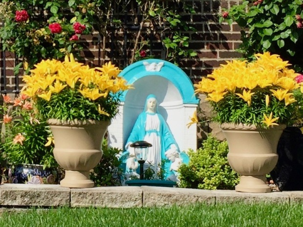 Mary statuette in front yard flower garden, Pittsburgh, PA