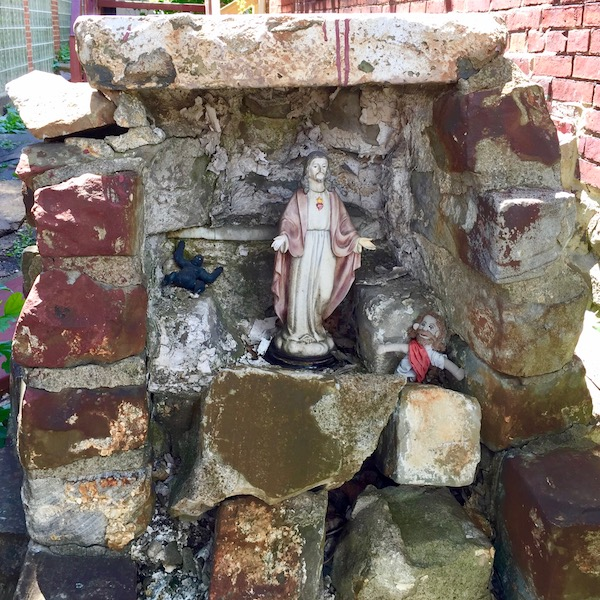 homemade brick Mary grotto with Jesus figurine and toys, Pittsburgh, PA
