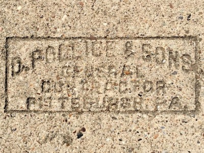 sidewalk stamp for D. Pollice & Sons, Pittsburgh, PA