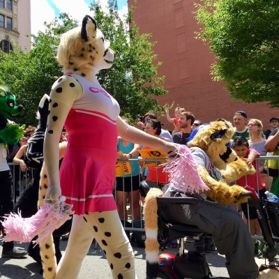 fursuit costome of leopard wearing cheerleader outfit, Anthrocon 2017 Fursuit Parade, Pittsburgh, PA