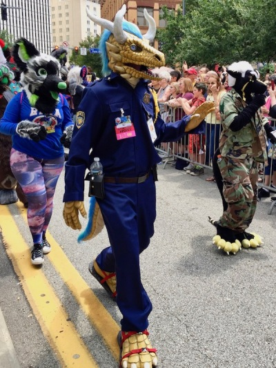 fursuit costume of dragon in police uniform, Anthrocon 2017 Fursuit Parade, Pittsburgh, PA