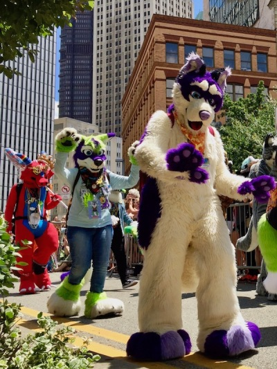 fursuit costume of white dog with purple features, Anthrocon 2017 Fursuit Parade, Pittsburgh, PA