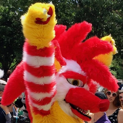 fursuit costume of scary rooster with arms extended over head, Anthrocon 2017 Fursuit Parade, Pittsburgh, PA