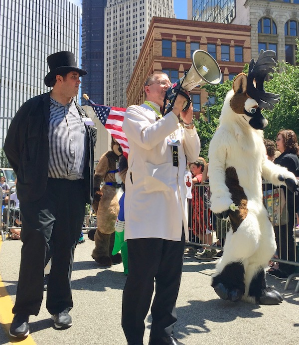 man with lab coat and bullhorn in Anthrocon 2017 Fursuit Parade, Pittsburgh, PA