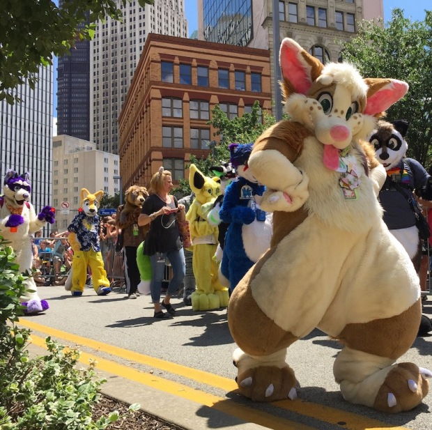 parade marchers in fursuits including large rabbit, Anthrocon 2017 Fursuit Parade, Pittsburgh, PA
