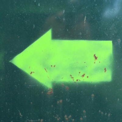 day-glo green arrow painted on dumpster, Pittsburgh, PA