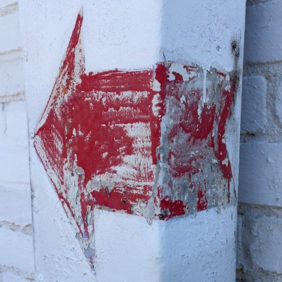 red arrow painted on exterior column, Pittsburgh, PA