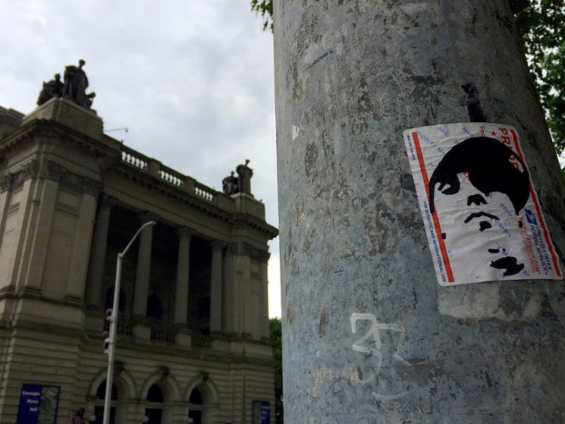 postal slap on light pole with portrait of young man in baseball cap, Pittsburgh, PA
