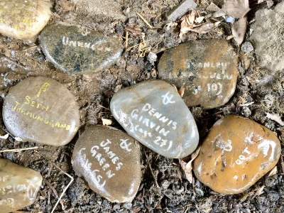 river stones labeled with peoples names and ages, Pittsburgh, PA