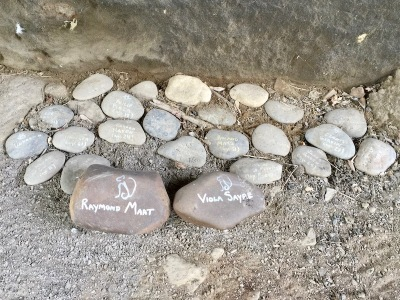 collection of river stones with barely-legible text written on them, Pittsburgh, PA