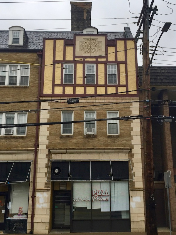 older brick apartment building with former Pizza Prima restaurant in ground floor space, Pittsburgh, PA