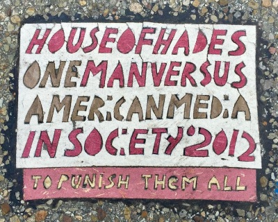 "House of Hades ""Toynbee Tile"" imprinted on city street, Pittsburgh, PA"