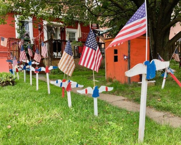 handmade wood cut eagles lawn decorations in back yard, Beaver, PA