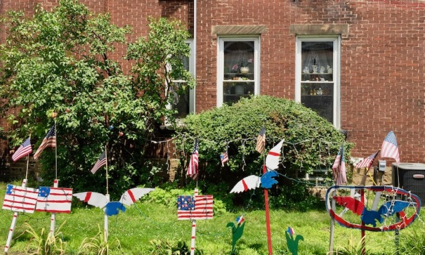 handmade wood cut Independence Day lawn decorations including flags, eagles, and star flowers, Beaver, PA