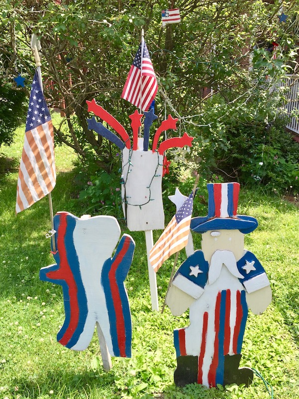 handmade wood cut Independence Day lawn decorations including teddy bear, fireworks, and Uncle Sam, Beaver, PA