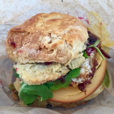 Egg biscuit with Gouda cheese, bacon, arugula, jalapeño peppers, and marionberry jam
