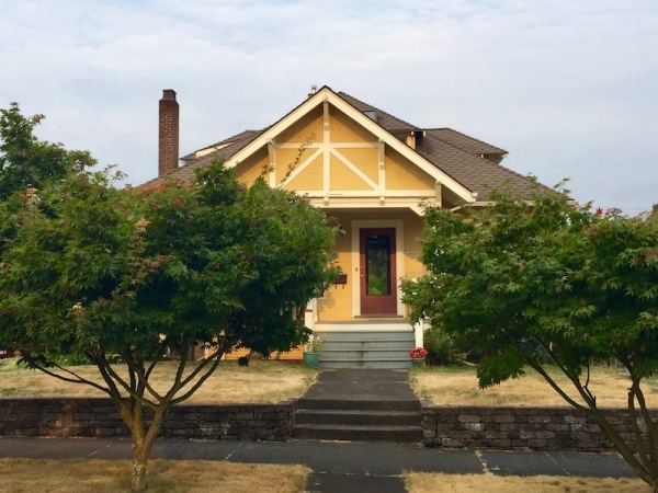 yellow bungalow house in Portland, OR