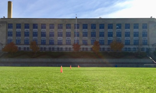Arsenal Middle School in Pittsburgh PA with a large green playing in front.