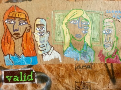 street art painting of four people with missplaced eyes, Pittsburgh, PA