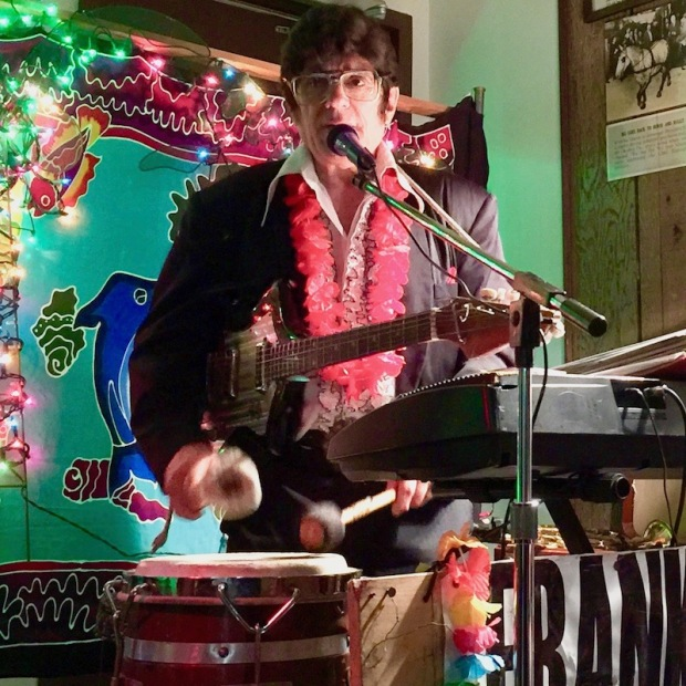 entertainer Frankie Capri in Elvis-style dress with electric guitar, keyboard, and conga drum