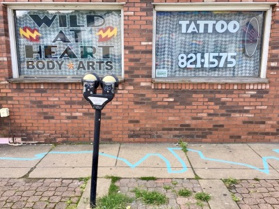 blue line painted in front of Wild at Heart Body Arts, Millvale, PA