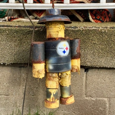 robot ornament made from tin cans, painted black with Steelers logo, New Kensington, PA