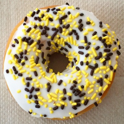doughnut with black-and-gold jimmies