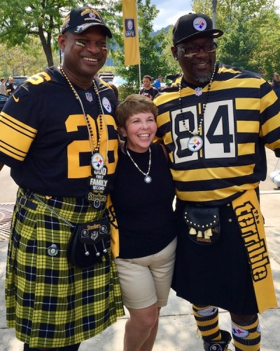 two men wearing black-and-gold kilts and Steelers jerseys at Heinz Field, Pittsburgh