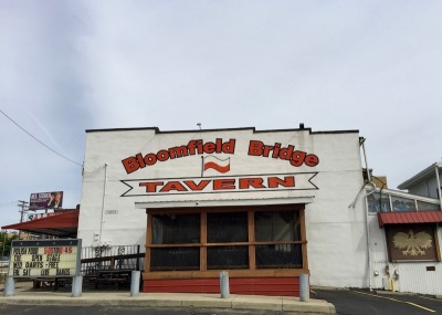 exterior of Bloomfield Bridge Tavern with Polish red and white flag and logo, Pittsburgh, PA