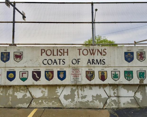 mural of Polish towns coats of arms painted on parking lot wall, Bloomfield Bridge Tavern, Pittsburgh, PA