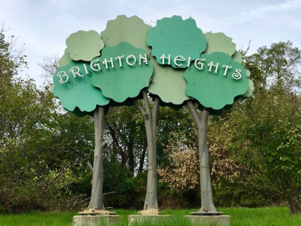 Brighton Heights neighborhood welcome sign as three threes with the name spelled out across the greenery, Pittsburgh, PA