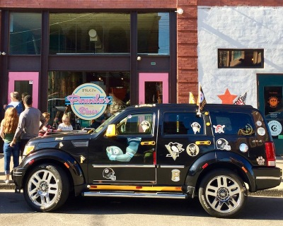 black SUV decorated with Pittsburgh Steelers and Pirates stickers