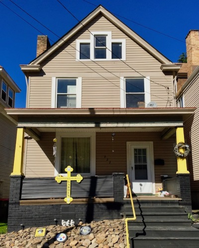 frame house with black-and-gold porch, Beaver Falls, PA