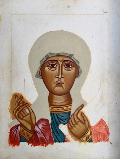 partial icon for St. Praskevia with only the face and hands painted