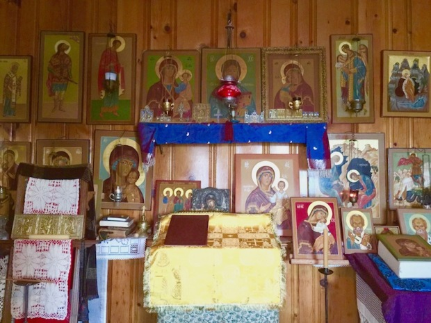 wall with dozens of traditional Russian Orthodox icons painted by Simeon Larivonovoff