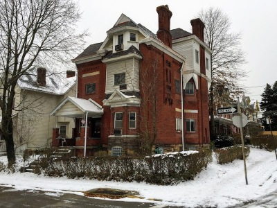 large brick Victorian house with snow-covered sidewalks, Pittsburgh, PA