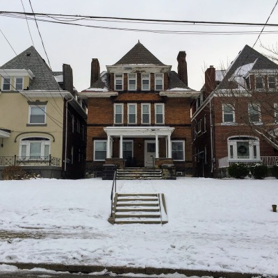 large brick house with snow-covered sidewalk, Pittsburgh, PA